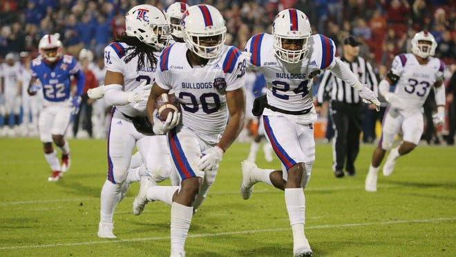 Louisiana Tech safety Darryl Lewis (38) runs 23 yards for a touchdown after intercepting an SMU pass during the second quarter on Wednesday.
