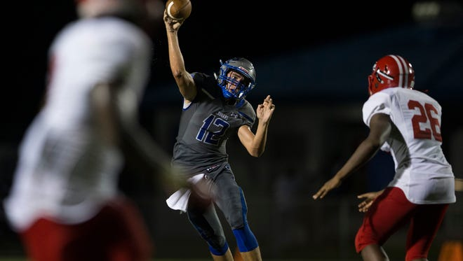 Barron Collier quarterback Jacob Kuhlman (12) throws the ball during the second half of action at Barron Collier High School Wednesday, September 6, 2017 in Naples. Immokalee defeated Barron Collier 48-40.