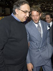 Chrysler CEO Sergio Marchionne, left,  talks to Agnelli