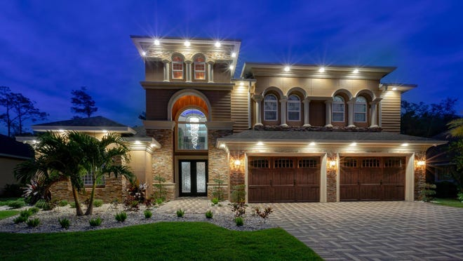 Beyond the gates of the prestigious Creekside Preserve community sits this luxurious custom-designed home, with off-the-charts curb appeal, thanks to the stunning, real-stone exterior and the herringbone paver driveway.
