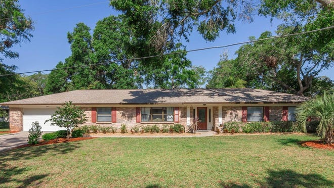 This lovely Tomoka Oaks pool home, sitting on a large corner lot, features nearly 2,200 square feet of living space that holds four bedrooms and two bathrooms, plus an office.