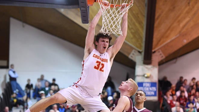 Bergen Catholic's Zachary Freemantle (32) celebrates a dunk against Bergen Catholic in the Bergen Jamboree Basketball Final against Don Bosco at the Rothman Center on Friday, February 23, 2018.