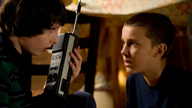 "Finn Wolfhard, left, and Millie Bobby Brown portray Mike and Eleven in ""Stranger Things."""