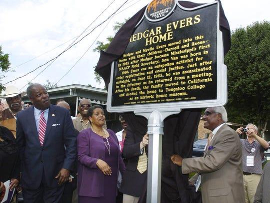 Reena Evers-Everette (left) former Jackson Mayor Harvey Johnson Jr., Myrlie Evers-Williams, and Leslie McLemore unveil the new Mississippi Freedom Trail Marker at the Medgar Evers Home Museum on Margaret Walker Alexander Drive in Jackson in 2011.