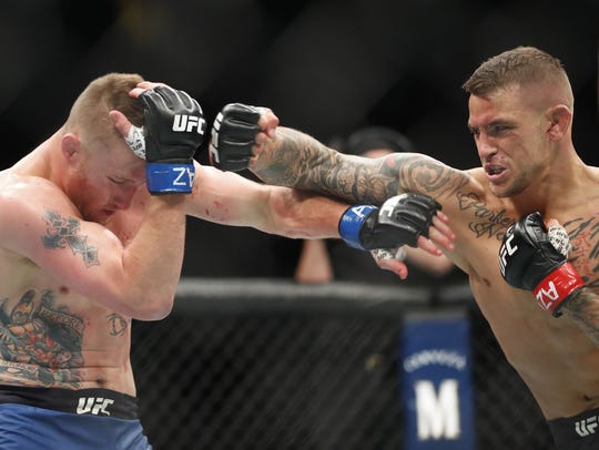 Dustin Poirier (R) throws a punch at Justin Gaethje