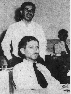 A photo from a 1948 edition of  The Arizona Republic shows Frank Robles, standing, and Sidney Kartus. Both men were booted out of the Arizona House in 1948, the first to be expelled.