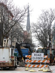 Construction crews work on a section of North Grand