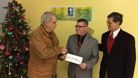 Frank Dixon (left), chairman emeritus, and Bob Phillips (right), vice chairman of the Francis J. Dixon Foundation, present a check in the amount of $10,000 to Troy E. Williams, executive director of Lebanon County Christian Ministries.