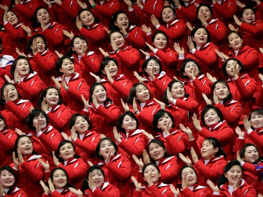 North Korean supporters cheer on Un Song Choe, of North Korea, during the 1500 meter short-track speedskating in the Gangneung Ice Arena at the 2018 Winter Olympics in Gangneung, South Korea, Saturday, Feb. 10, 2018. (AP Photo/Julie Jacobson)