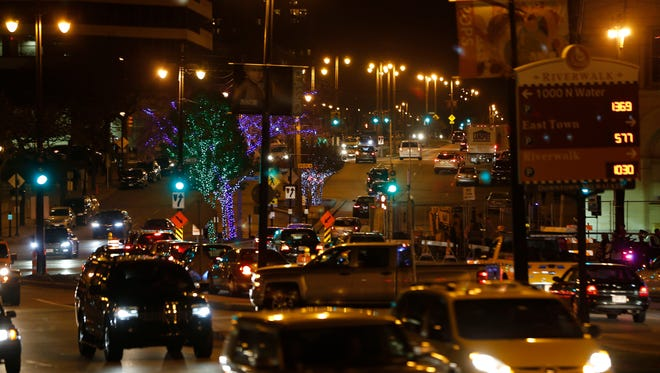 City sidewalks, busy sidewalks in downtown Milwaukee after the opening of the Holiday Lights display in 2016.
