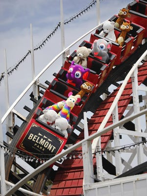 Stuffed animals ride the Giant Dipper roller coaster at Belmont Park in Mission Beach on Monday. The park has been running the coaster to keep it from tightening up during the recent closures.