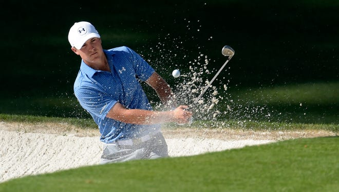Jordan Spieth chips out of a bunker on the 10th hole during the third round of the Masters.