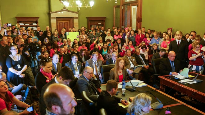 Planned Parenthood supporters and opponents pack a Senate committee meeting about Planned Parenthood defunding on Tuesday, Jan. 31, 2017. The debate over a new family planning program plan to bar abortion providers from participating in state-financed family planning efforts sparked angry controversy at the Statehouse this spring.
