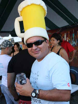A craft beer fan enjoys some suds and fun at the 2014 Sun City Craft Beer Festival. The festival returns to Downtown on Saturday.