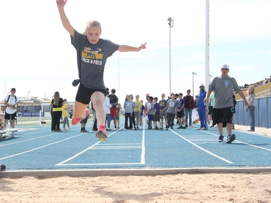 Fifth grader McKenzie McAvoy participates in the long