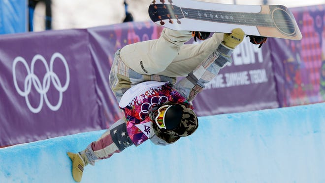 FILE - In this Feb. 11, 2014, file photo, Danny Davis, of the United States, competes in the men's snowboard halfpipe qualifying at the Rosa Khutor Extreme Park at the 2014 Winter Olympics in Krasnaya Polyana, Russia. Davis' latest injury came far from the halfpipe. The snowboarder was chopping firewood at his home in California last month when the ax slid off the wood and into his right hand, cutting through tendons. (AP Photo/Andy Wong, File)