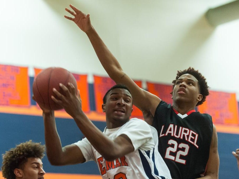 Delmar forward Kavon Trader (33) attempts a shot as Laurel guard Raquel Pacheco (22) goes for a block at Delmar on Tuesday evening.