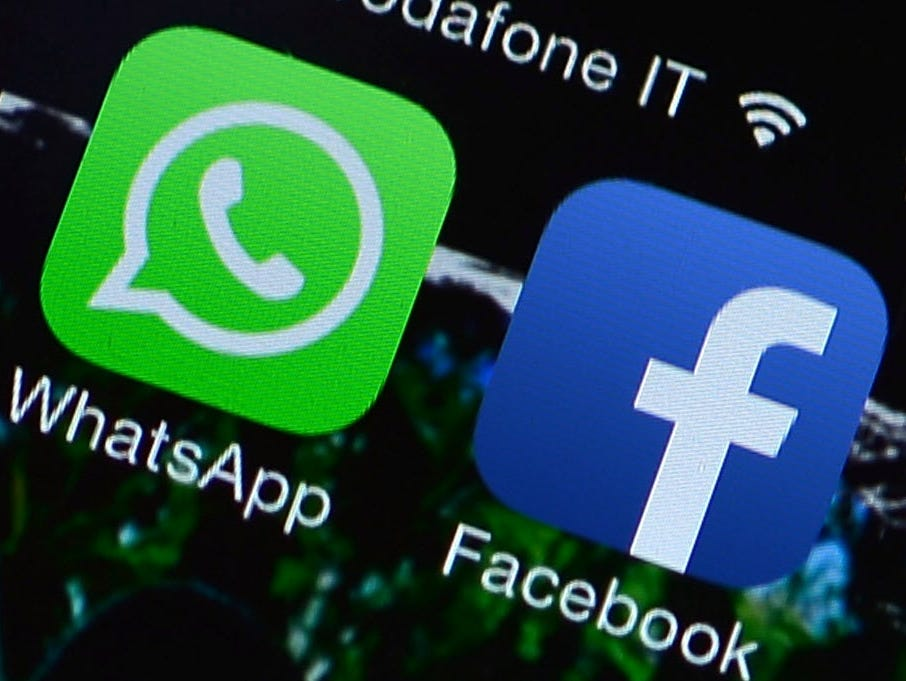 The Facebook and WhatsApp applications' icons are displayed on a smartphone on February 20, 2014.