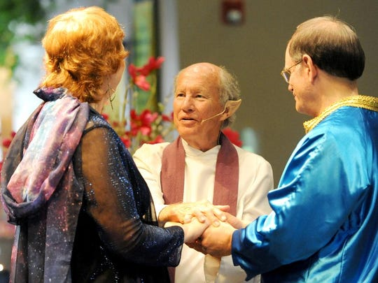 Howard Hanger, minister of ritual and celebration at Jubilee!, wears Vulcan ears to fit into the theme as he marries Diane Stanton, left, and Richard Heim on Saturday, May 23, 2015.