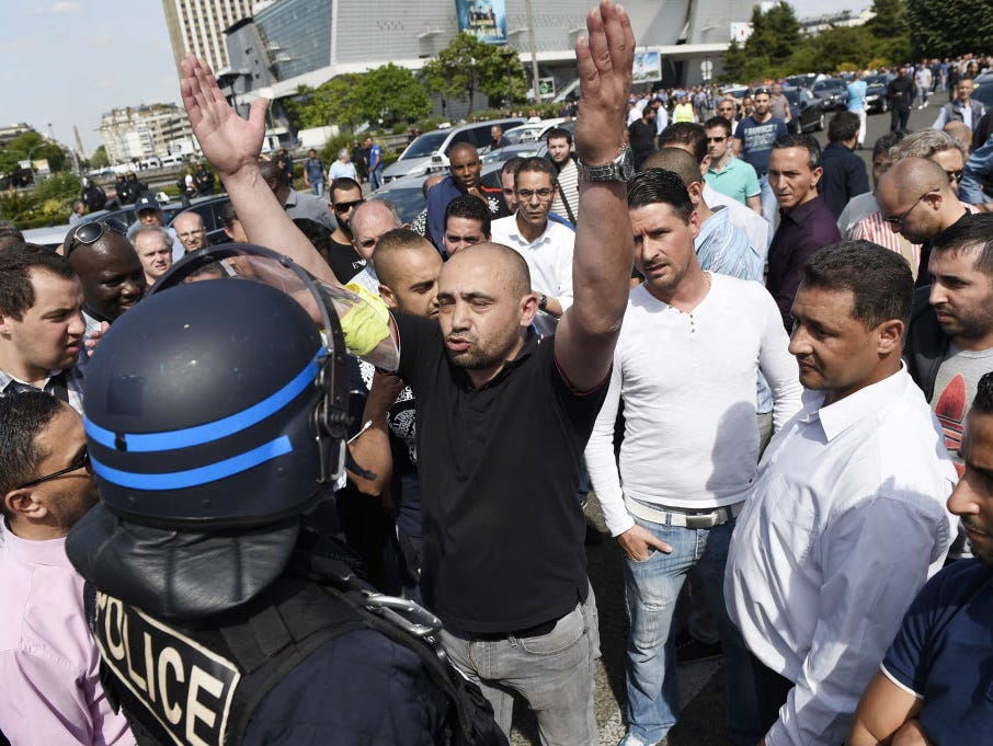 French cab drivers protesting Uber's presence on Parisian streets confront riot police last week.