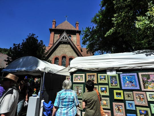 The Village Arts and Crafts Fair brings dozens of artists to Biltmore Village each summer.