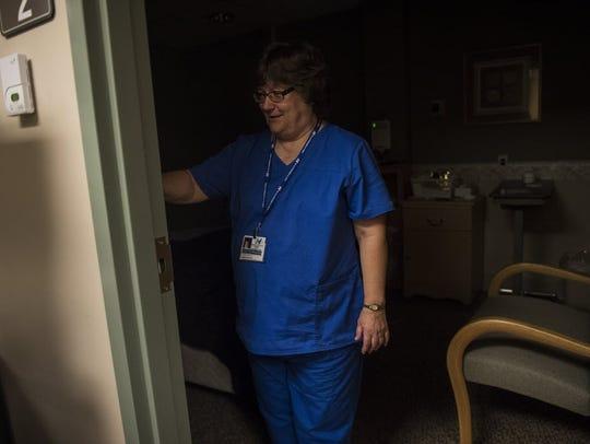 Sleep technician Elaine Sheely turns out the light