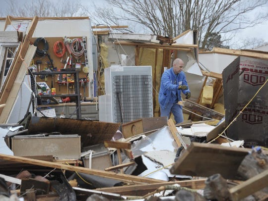 A home is completely destroyed in the Northpointe neighborhood.