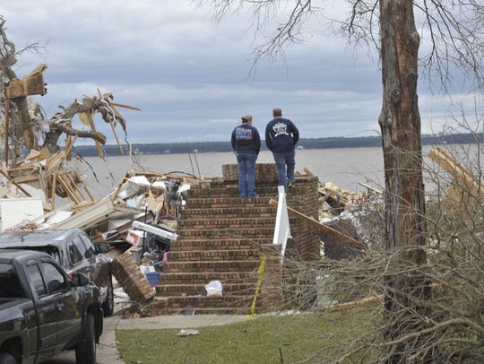 Officials survey the damage at Grand Barque in Pensacola