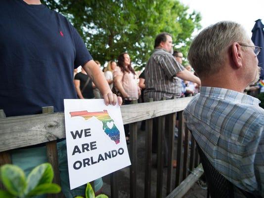 636014816850893858-LGBT-vigil-O.-Henrys-16-.jpg
