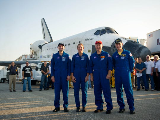 The STS-135 astronauts, from left, mission specialists