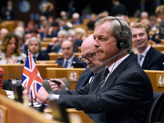 U.K. Independence Party leader Nigel Farage attends a session at the European Union's headquarters in Brussels this past June. Mississippi Gov. Phil Bryant is responsible for one of the most notable political hookups in recent history according to new book: Donald Trump and Farage.