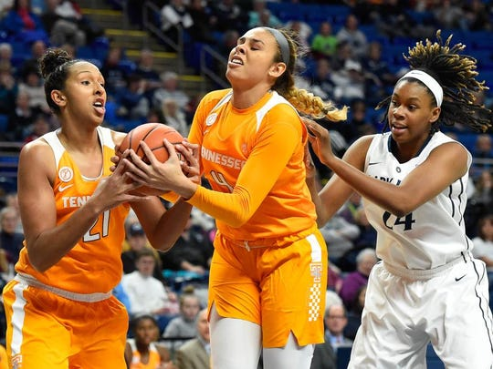 Tennessee's Mercedes Russell, jeft, and Schaquilla Nunn battle for control of the ball as Penn State's Ashanti Thomas defends Sunday in University Park, Pa.