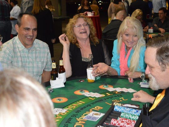 Casino Night guests share a laugh.