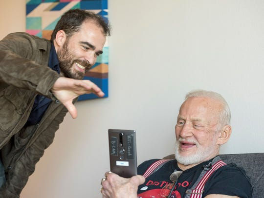 Linc Gasking, 8i Co-founder, shows astronaut Buzz Aldrin