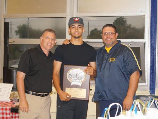 Belleville's Brayan Villar (center) received the prestigious
