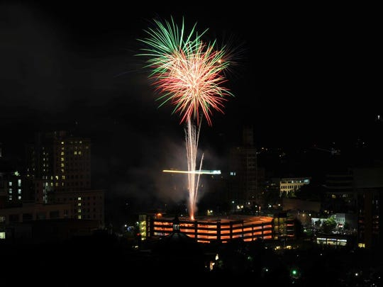 Fireworks are set off over downtown Asheville on July 4, 2017.