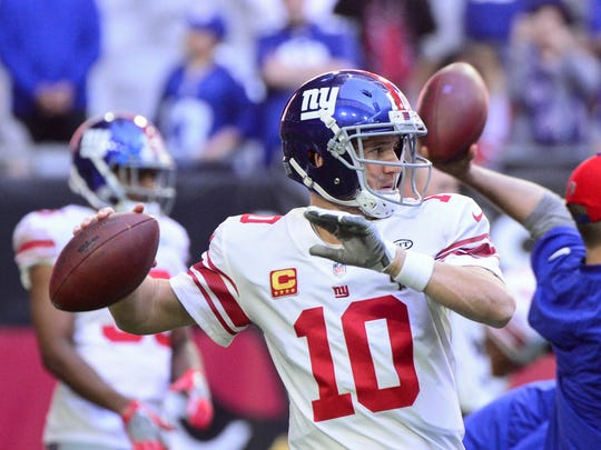 New York Giants quarterback Eli Manning (10) warms up prior to a game against the Arizona Cardinals at University of Phoenix Stadium.