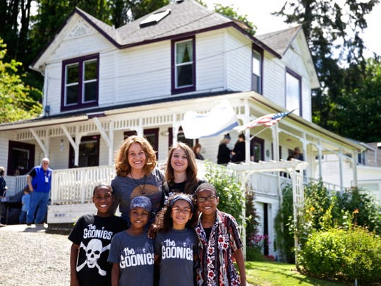 This June 2014 photo shows Devonte Hart with his family