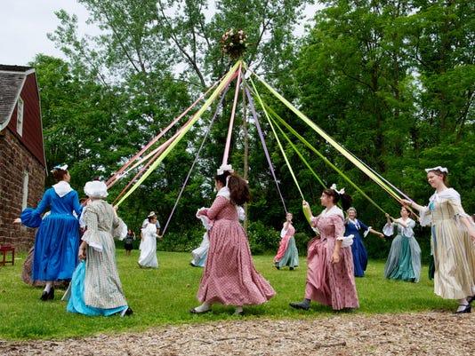 Maypole dancers celebrate May Day, 2010