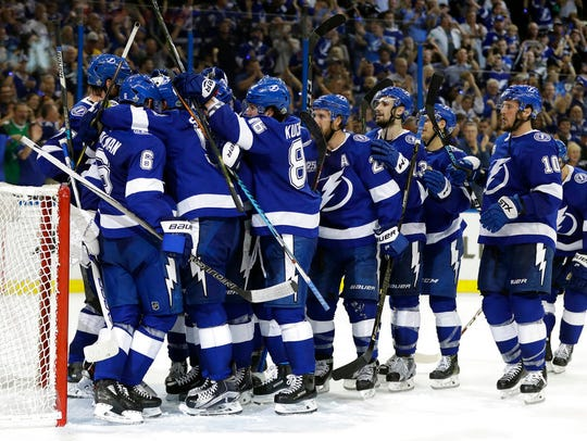 The Tampa Bay Lightning celebrate their win over the