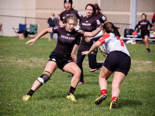 Ambrie Cwik, outside center on IU's women's rugby team takes on Ohio State University. The team is 9-1 heading into the national semifinals of the USA Rugby Women's Collegiate Fall Championship.