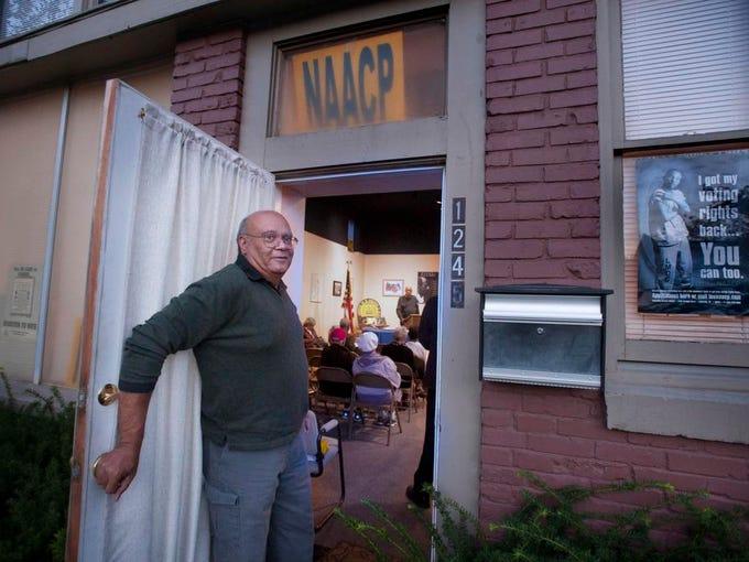 Haven Harrington opens the door of the Louisville branch