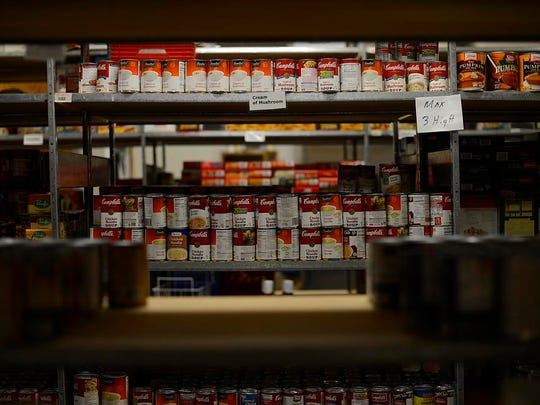 Items sit on shelves inside the De Pere Christian Outreach Food Pantry in De Pere on Wednesday, Nov. 5, 2014.