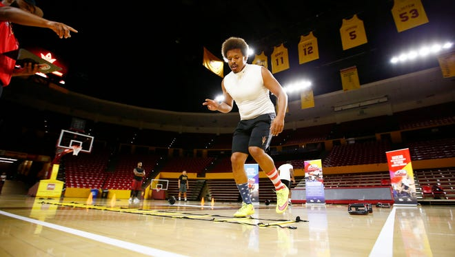 Former ASU football safety Charles Beatty tries to qualify for NASCAR Drive for Diversity Pit Crew National Combine during trials on Thursday, April. 20, 2017 at ASU in Tempe, Ariz.