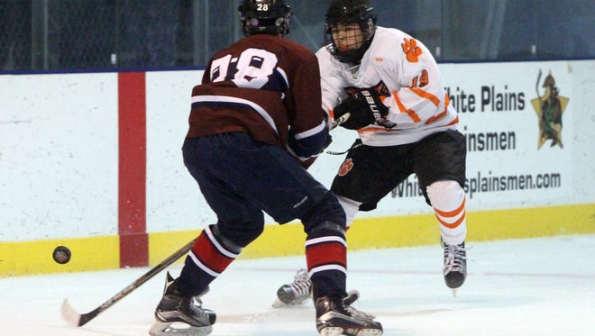 White Plains' Ian Chochrek gets a shot past The Harvey School's Jude Brower during their game at the Guy Mathews Thanksgiving Invitational Hockey Tournament at Ebersole Ice Rink in White Plains, Nov. 25, 2016.