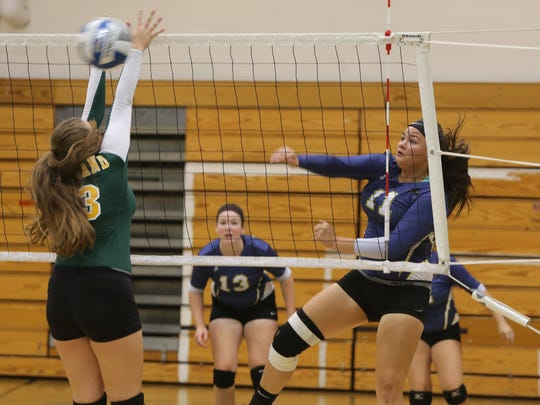 Ardsley's Nicolina Chenard gets the ball past Lakeland's Selvja Dedushaj as eight lower Hudson Valley teams participated in the 40th annual Yorktown varsity volleyball tournament at the school, Sept. 19, 2015.