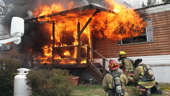 Brewster firefighters prepare to attack a fully engulfed trailer fire in a mobile home park on Danbury Road in Southeast April 27, 2014. There were no injuries and the trailer was destroyed.