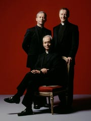 The Priests, a classical musical group of three Roman Catholic priests from Northern Ireland, will perform at UW-Green Bay's Weidner Center for the Performing Arts at 7:30 p.m. Friday, March 20. The Rev. Eugene O'Hagan, seated, is flanked by his brother the Rev. Martin O'Hagan, left, and the Rev. David Delargy.