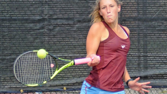 Salina Central senior Callie Sanborn hits a forehand against Goddard Eisenhower's Annabelle Aldrete in the singles semifinals of the Ark Valley Chisholm Trail League Division II tournament Monday at the Central tennis courts. Sanborn won the match, 6-0, 6-0 and went on to finish second.