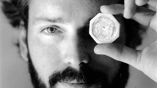 In this November 1989 file photo, Tommy Thompson holds a $50 pioneer gold piece retrieved earlier in 1989 from the wreck of the gold ship Central America. According to the US Marshals Service,  Thompson, a fugitive treasure hunter wanted for more than 2 years was arrested in Florida.